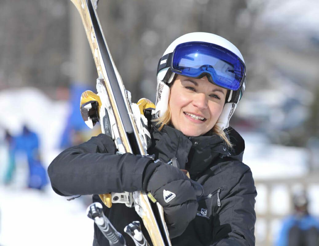 Woman smiling ready to ski